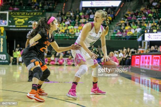 Baylor Bears guard Kristy Wallace is guarded by Oklahoma State Cowgirls guard Karli Wheeler during the women's basketball game between Baylor and...
