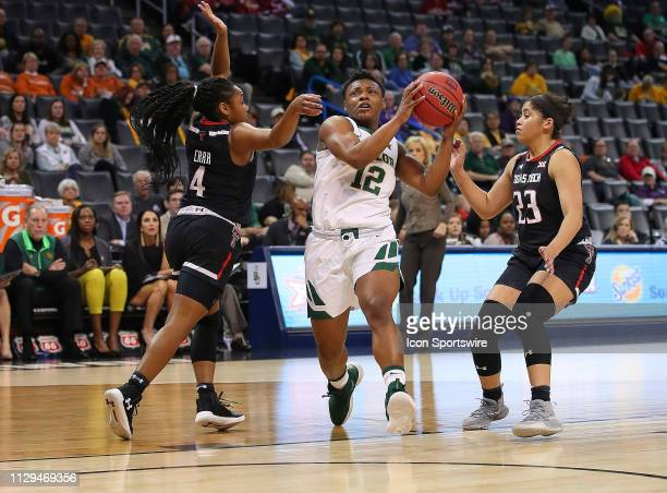 Baylor Bears Guard Moon Ursin eyes a bucket during the BIG12 Women's basketball tournament between the Baylor and the Texas Tech on March 9 at the...