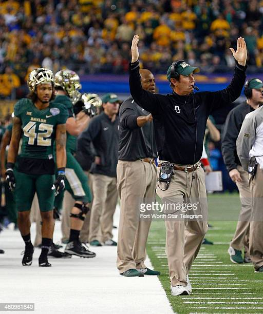Baylor Bears head coach Art Briles gestures after a touchdown against the Michigan State Spartans in the second quarter at the Goodyear Cotton Bowl...