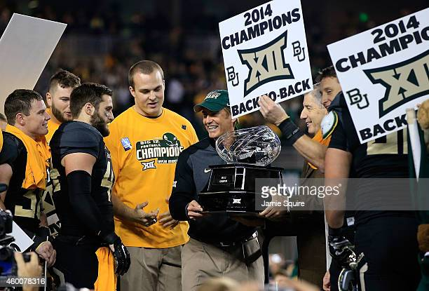 Baylor Bears head coach Art Briles holds the Big 12 Championship trophy following their win over Kansas State Wildcats on December 6, 2014 at McLane...