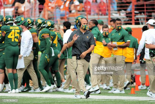 Baylor Bears head coach Dave Aranda talks on his intercom during game featuring the Baylor Bears and the Texas Longhorns on October 24 at Darrell K...