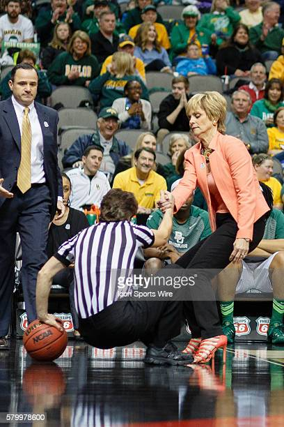 Baylor Bears head coach Kim Mulkey helps a fallen referee during the NCAA Big 12 Women's basketball championship game between the Baylor Bears and...