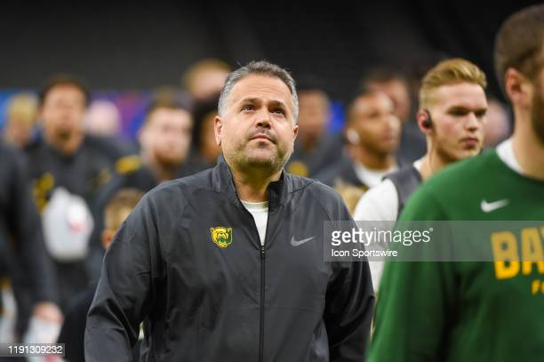 Baylor Bears head coach Matt Rhule leads his team across the field as they enter the stadium for the first time before the Sugar Bowl football game...