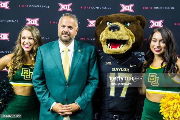 Baylor Bears head coach Matt Rhule poses with cheerleaders and the mascot during the Big 12 Media days on July 17 2018 at the Ford Center at The Star...