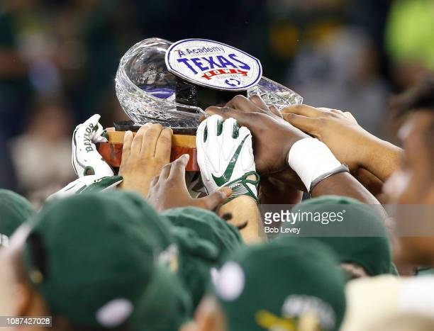 Baylor Bears hoist the championship trophy as they defeat the Vanderbilt Commodores 4835 during the Academy Sports Outdoors Texas Bowl at NRG Stadium...