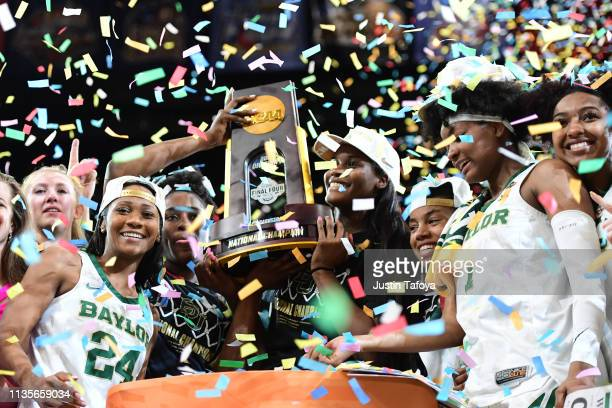Baylor Bears players celebrate their win over the Notre Dame Fighting Irish at Amalie Arena on April 7, 2019 in Tampa, Florida.