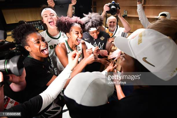 Baylor Bears players celebrate their win over the Notre Dame Fighting Irish at Amalie Arena on April 7 2019 in Tampa Florida