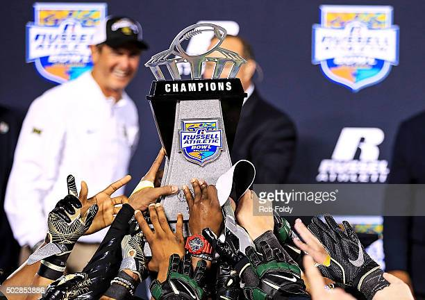 Baylor Bears players hold the chapionship trophy as head coach Art Briles looks on after the Russell Athletic Bowl game against the North Carolina...