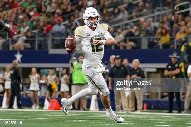 Baylor Bears quarterback Charlie Brewer scrambles during the TFBI Shootout between the Baylor Bears and Texas Tech Red Raiders on November 24 2018 at...