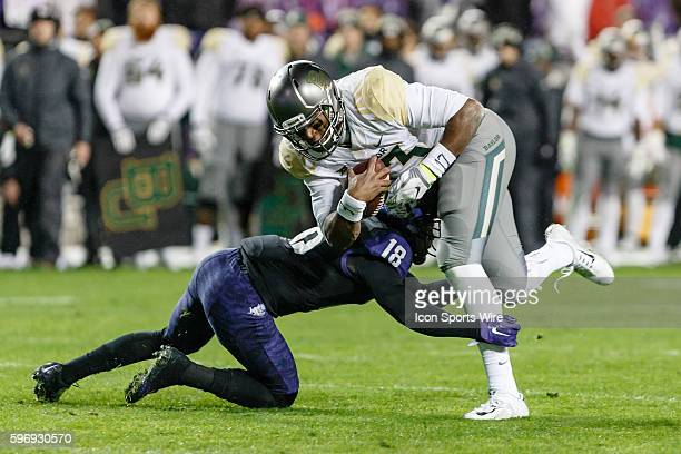 Baylor Bears quarterback Chris Johnson is tackled by TCU Horned Frogs safety Nick Orr during the NCAA Big 12 football game between the TCU Horned...