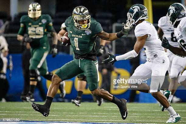 Baylor Bears running back Corey Coleman stiff arms Michigan State Spartans cornerback Darian Hicks during the Goodyear Cotton Bowl Classic between...