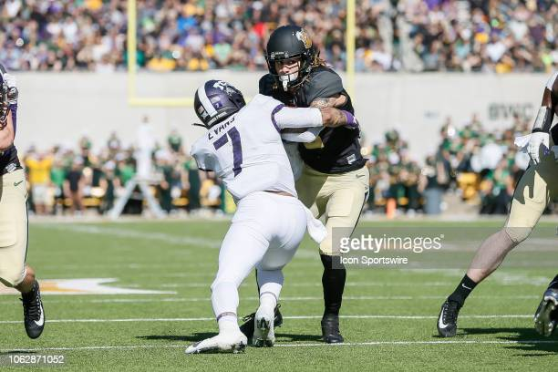Baylor Bears wide receiver Jalen Hurd gets tackled by TCU Horned Frogs linebacker Arico Evans during the game between the Baylor Bears and the TCU...
