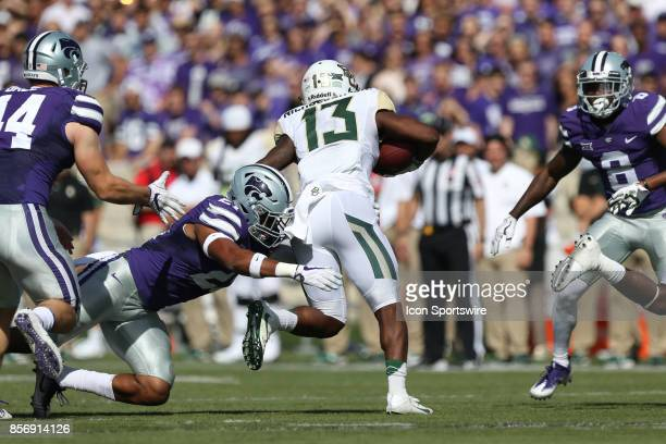 Baylor Bears wide receiver Tony Nicholson is tackled by Kansas State Wildcats defensive back Kendall Adams after a catch in the first half of a Big...