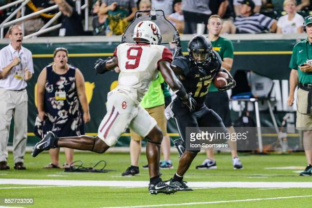Baylor Bears wide receiver Tony Nicholson stiff arms Oklahoma Sooners linebacker Kenneth Murray during the game between the Baylor Bears and the...