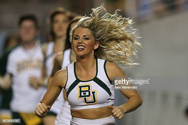 Baylor cheerleader celebrates a touchdown during the NCAA Russell Athletic Bowl between the Baylor Bears and the North Carolina Tar Heels on December...