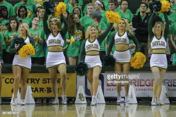 Baylor cheerleaders perform during the men's basketball game between Baylor and West Virginia on February 27 at the Ferrell Center in Waco TX