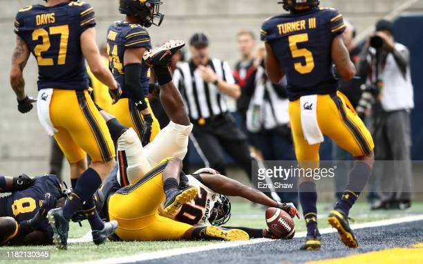 J Baylor of the Oregon State Beavers reaches in for the winning touchdown in the fourth quarter against the California Golden Bears at California...