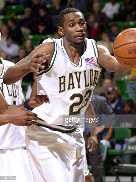 Baylor University basketball player Carlton Dotson reaches for the ball during a game against Montana State at the Ferrell Center December 14 2002 in...