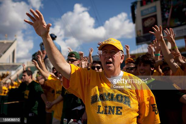 Baylor University President Ken Starr cheers with students prior to kickoff against the University of Kansas Jayhawks on November 3 2012 at Floyd...