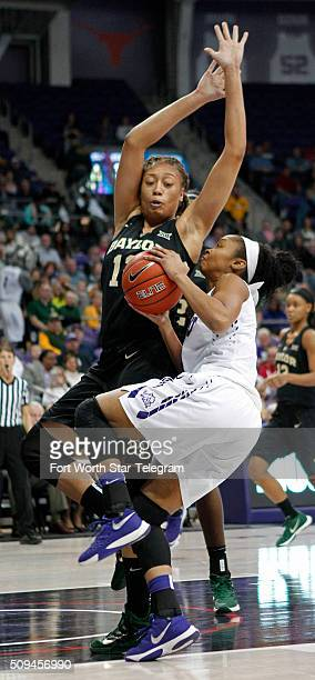 Baylor's Alexis Prince defends against Texas Christian's Toree Thompson in the second period on Wednesday, Feb. 10 in Fort Worth, Texas. Baylor won,...