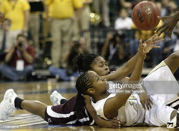Baylor's Angela Tisdale passes the ball to a teammate after wrestling is away from Texas AM's A'Quonesia Franklin in the first half of the Women's...