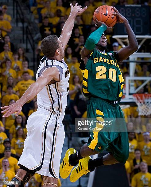 Baylor's Stargell Love nails a long 3point buzzerbeater over Missouri's Justin Safford to end the first half at Mizzou Arena in Columbia Missouri on...