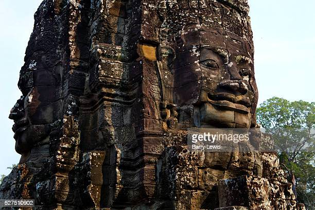 Bayon Temple, Ankor. Bayon is known for its huge stone faces of the bodhisattva Avalokiteshvara, with one facing outward and keeping watch at each...