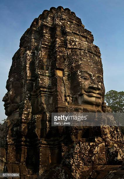Bayon Temple Ankor Bayon is known for its huge stone faces of the bodhisattva Avalokiteshvara with one facing outward and keeping watch at each...