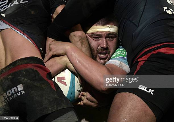 TOPSHOT Bayonne's French hooker Simon Labouyrie fights for the ball in a scrum during the French Top 14 rugby union match between Bayonne and...