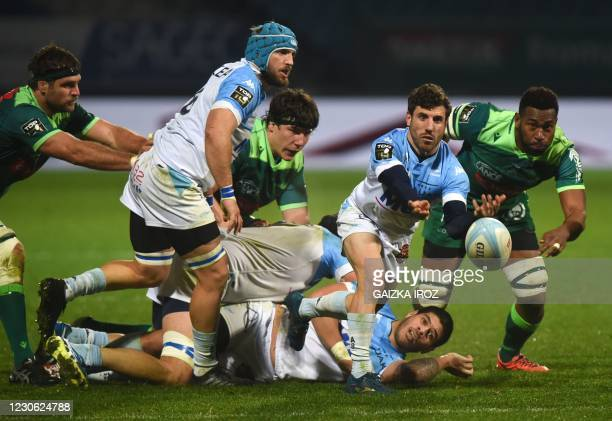 Bayonne's French scrum-half Guillaume Rouet passes the ball during the French Top14 rugby union match between Aviron Bayonnais and Section Paloise at...