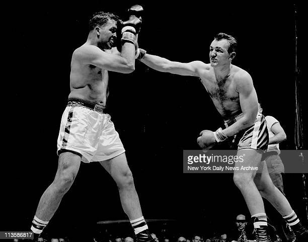 Bayonne's own Chuck Wepner throws a long right hand at Staten Islander James Sullivan in the 1964 heavyweight subnovice championship The fight a...