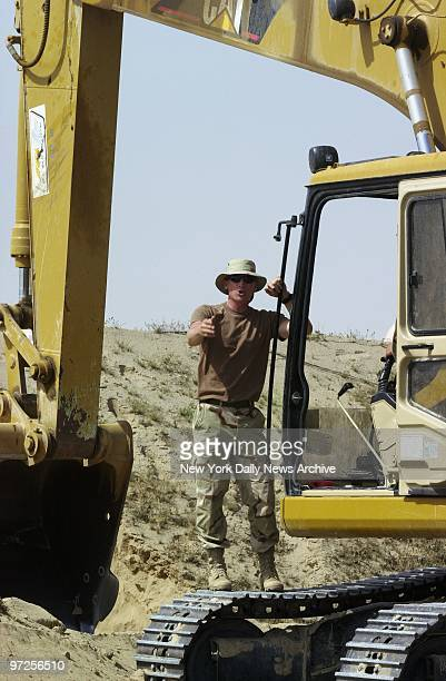 Bayside Queens resident Paul Franco a firefighter at Engine Co 76 in Manhattan is busy building bunkers for Marines at Al Jaber Air Base in Kuwait...