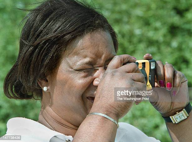 FILE Bayview resident Barbara Davis uses her disposable camera to record the last moments of one of the homes being demolished in Bayview Virginia on...