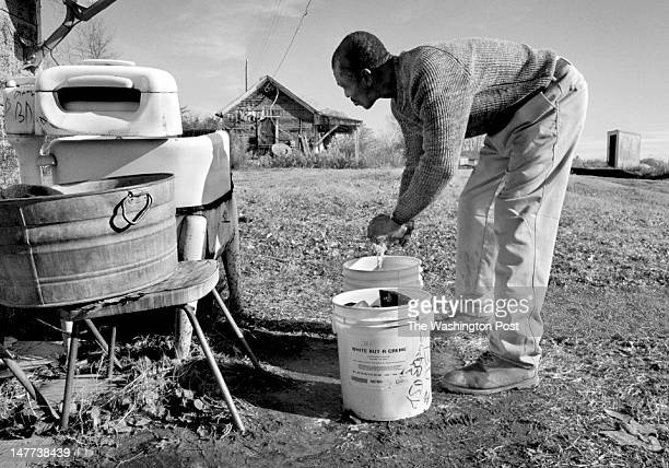 FILE Bayview resident Bobby Collins does laundry by hand outside of his shack in Bayview Virginia on December 12 2002 He probably will be able to get...