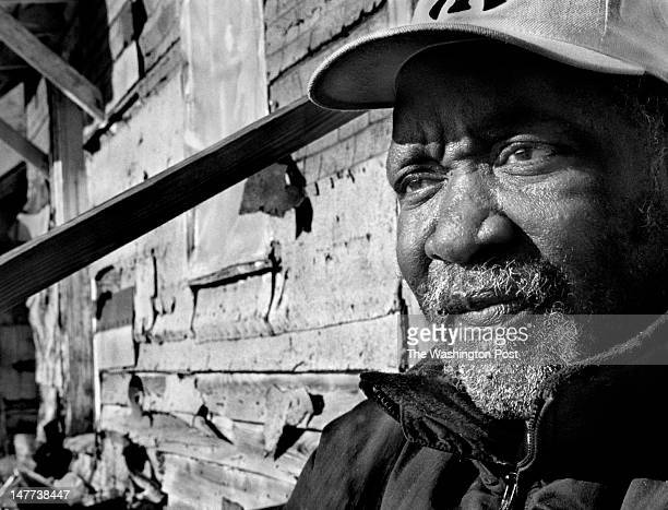 FILE Bayview resident Ed Johnson looks out at the construction going on outside of his shack in Bayview Virginia on December 12 2002 He probably will...