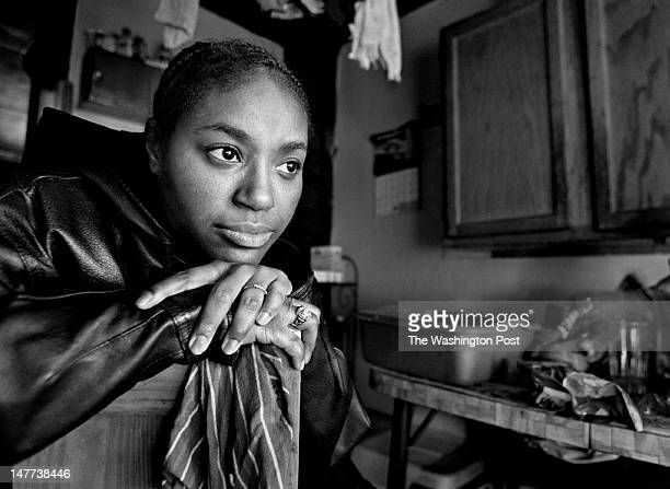 FILE Bayview resident Kishia Stratton grew up in this tin shack in Bayview Virginia on December 12 2002 She remembers life in it with no running...