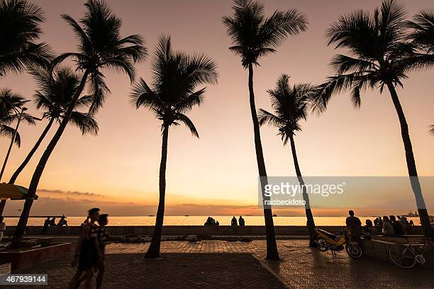 baywalk at dusk in manila, philippines - manila bay stock photos and pictures