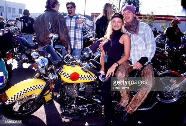 Baywatch actress Pamela Anderson and boyfriend Bret Michaels at the Aids benefit Love Ride 2 November 9 1994 Castaic Lake California