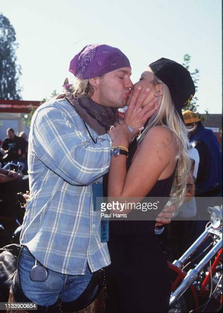 Baywatch actress Pamela Anderson kisses boyfriend Bret Michaels at the Aids benefit Love Ride 2 November 9 1994 Castaic Lake California