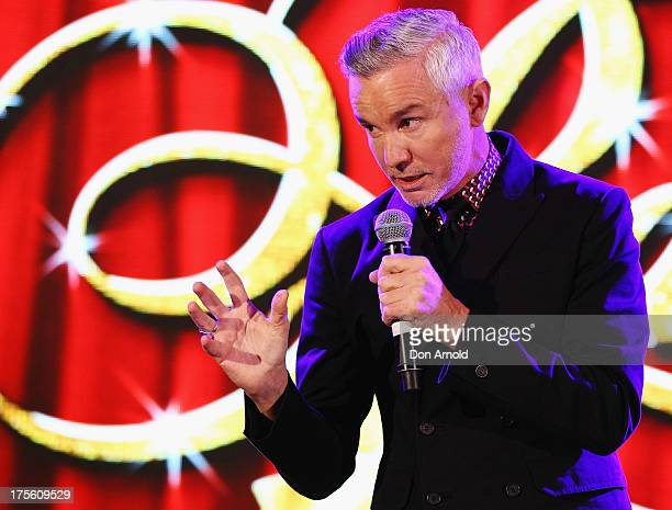 Baz Luhrmann addresses the media during the photo call for 'Strictly Ballroom The Musical' at Town Hall on August 5 2013 in Sydney Australia