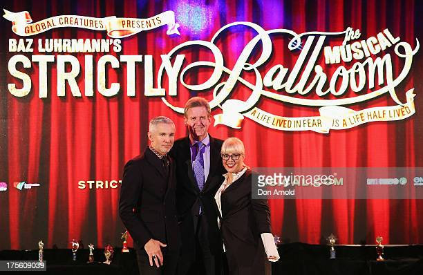 Baz Luhrmann Barry O'Farrell and Catherine Martin pose on stage during the photo call for 'Strictly Ballroom The Musical' at Town Hall on August 5...
