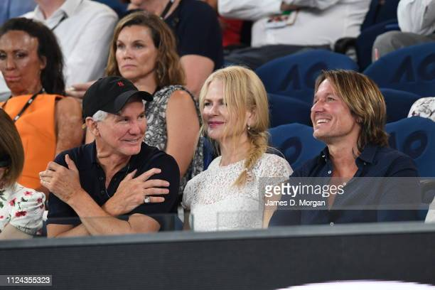 Baz Luhrmann Nicole Kidman and Keith Urban watch one of the women's semi finals on Rod Laver Arena as they attend the 2019 Australian Open at...