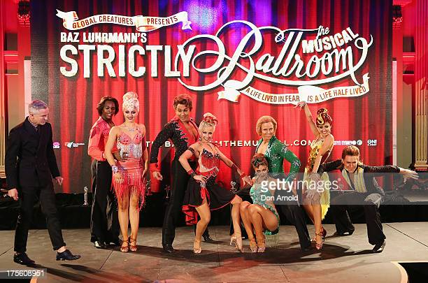 Baz Luhrmann poses alongside performers during the photo call for 'Strictly Ballroom The Musical' at Town Hall on August 5 2013 in Sydney Australia