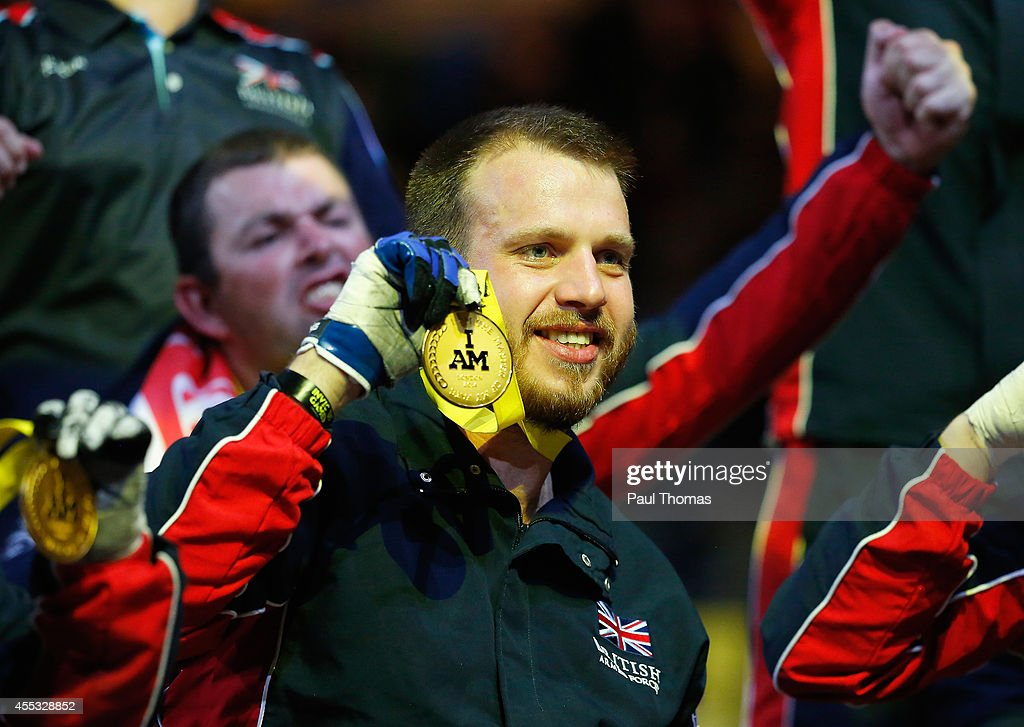 Baz Whittingham of Great Britain celebrates with his gold medal after the Wheelchair Rugby Gold medal match against the United States during day 2 of the Invictus Games, presented by Jaguar Land Rover at the Copper Box Arena on September 12, 2014 in London, England.