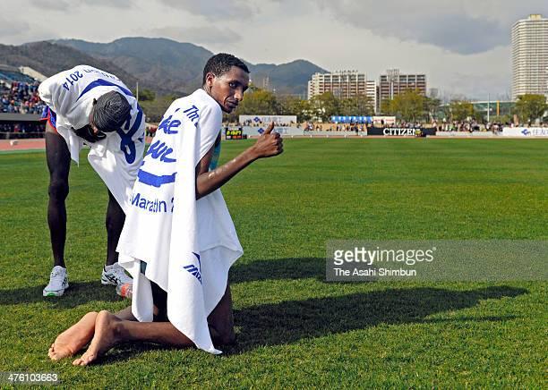 Bazu Worku of Ethiopia celebrates winning the 69th Lake Biwa Mainichi Maration at Ojiyama Stadium on March 2 2014 in Otsu Shiga Japan