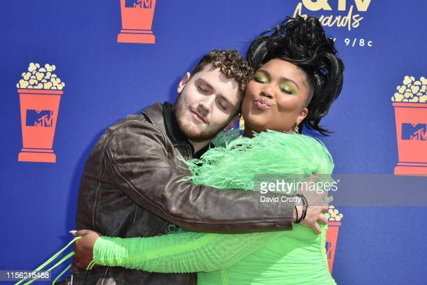 Bazzi and Lizzo attend the 2019 MTV Movie TV Awards at Barker Hangar on June 15 2019 in Santa Monica California