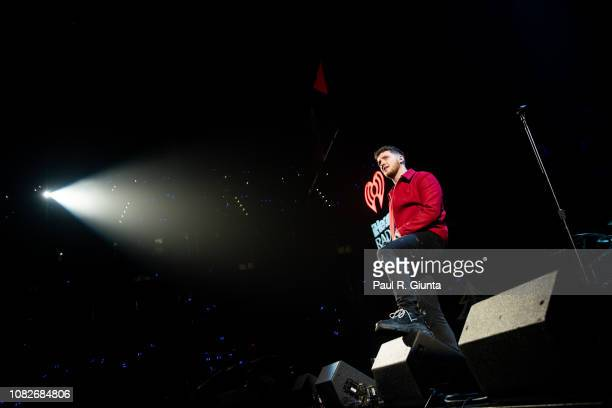 Bazzi performs on stage at Power 961's iHeartRadio Jingle Ball at State Farm Arena on December 14 2018 in Atlanta Georgia