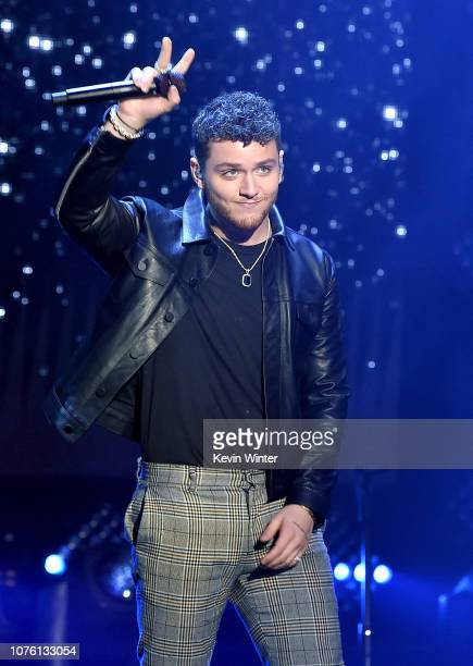 Bazzi performs onstage during Dick Clark's New Year's Rockin' Eve With Ryan Seacrest 2019 on December 31 2018 in Los Angeles California
