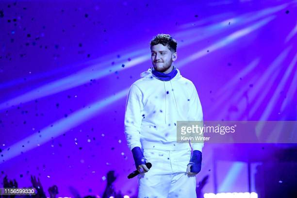 Bazzi performs onstage during the 2019 MTV Movie and TV Awards at Barker Hangar on June 15 2019 in Santa Monica California