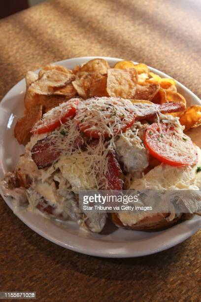 BISPING • bbisping@startribunecom Golden Valley MN Friday 4/24/2009] Mike's Kentucky Hot Brown turkey with parmesan cheese sauce grilled tomatoes...